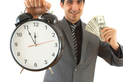 businessman with clock and Us dollars on white, shallow dof