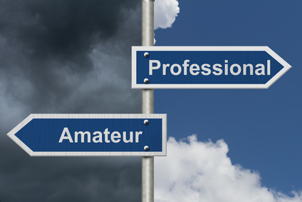 Difference between being a professional or an amateur , Two Blue Road Sign with text Professional and Amateur with bright and stormy sky background